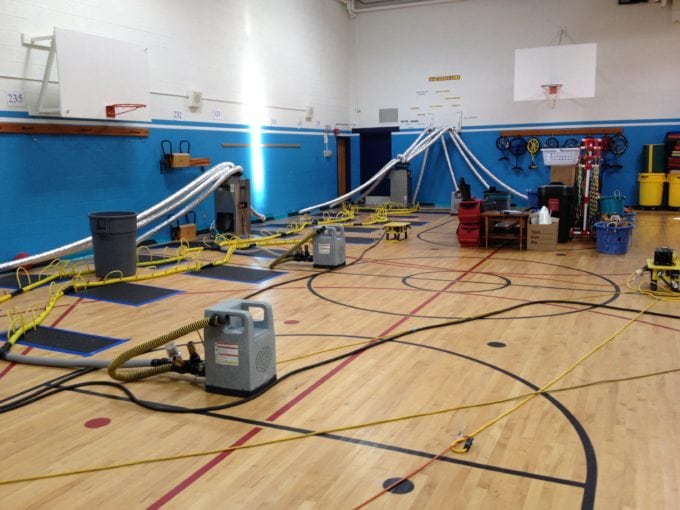 Surface and subsurface drying of a gym floor